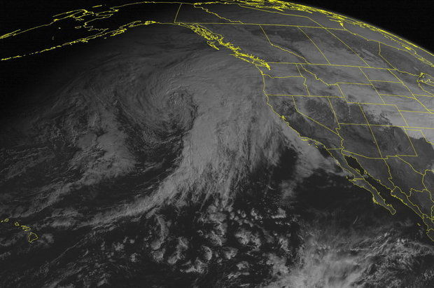 This satellite photo taken Wednesday shows the massive storm in the eastern Pacific. The system will bring rain to the Northwest and snow to the mountains, according to the National Weather Service (Weather Underground / Associated Press