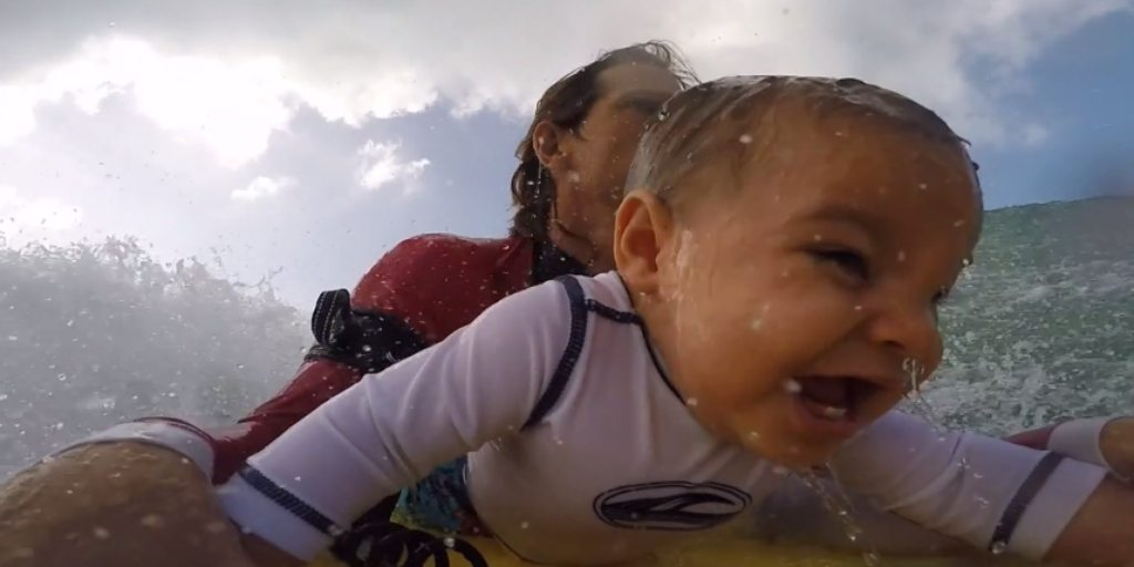 Father captures his toddler's first experience bodyboarding with GoPro (Video)