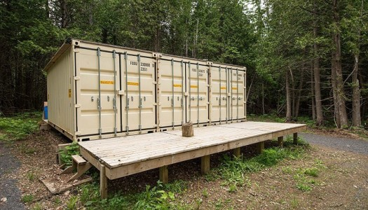 Just an ugly shipping container in the woods right? Look again.