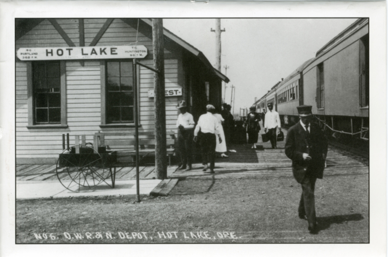 A postcard features an old photo of Hot Lake's train depot.