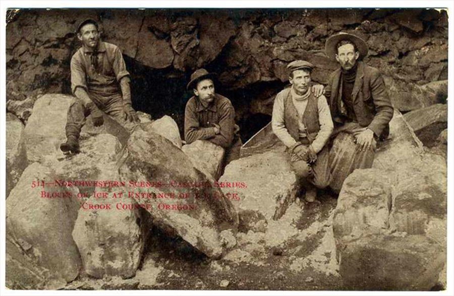 Another 1910s postcard, this one in black-and-white, shows Crook County men getting large blocks of ice out of a Central Oregon cave.
