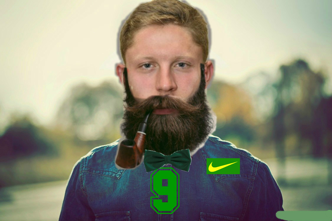 Dakota Prukop models the hipster-inspired football jersey the Ducks will be wearing Nov. 12 vs. Stanford at Autzen Stadium. All players will be growing their beards for this occasion, but Prukop wore a fake beard for this promotional photo.