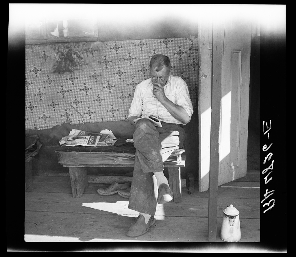 A part-time fruit worker in his squatter's shack under the Ross Island Bridge. Portland, Oregon