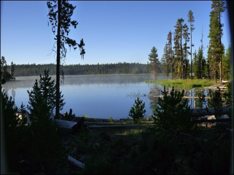 Little Lava Lake on a lovely summer day. Photo was taken by the author during a search for the old site of the Trapper's cabin. The cabin itself no longer exists.