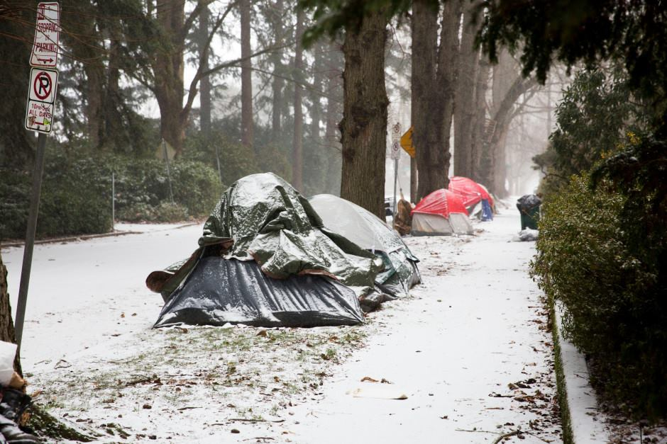 Tents gather snow during a winter storm on Saturday, Jan. 7, 2017. Of five occupants interviewed, none knew the location of warming shelters, and only one expressed interest in going. John Rosman/OPB