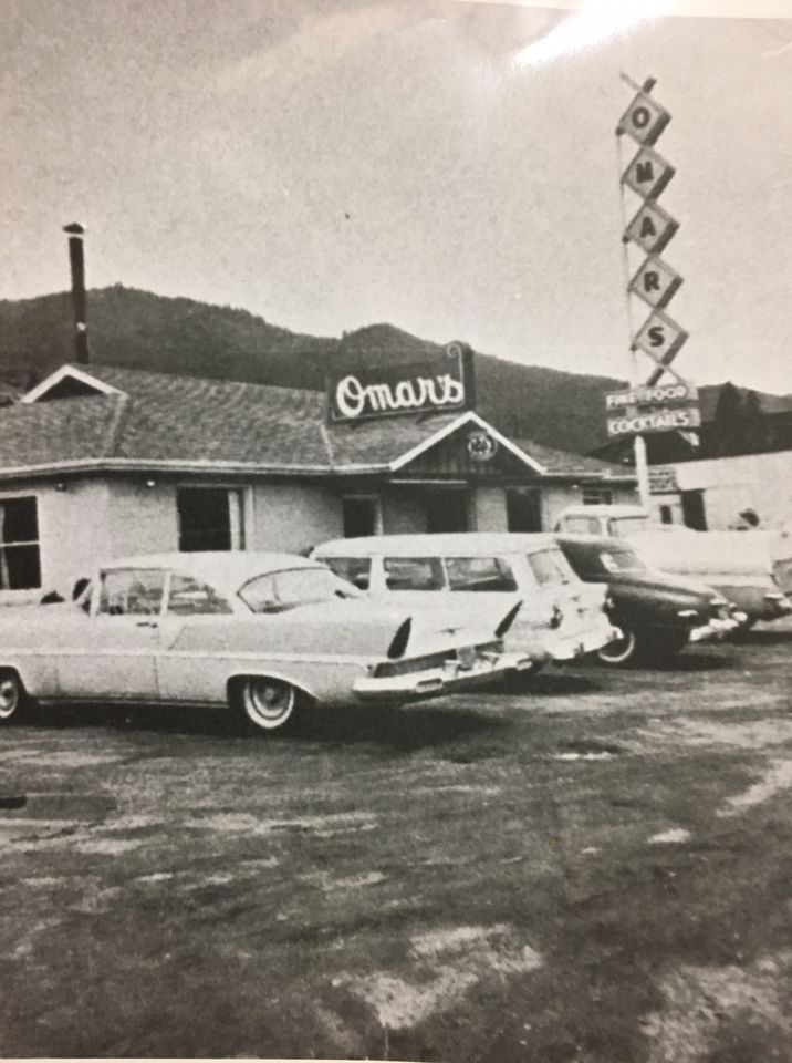 a black and white photo of the outside of Omar's restaurant