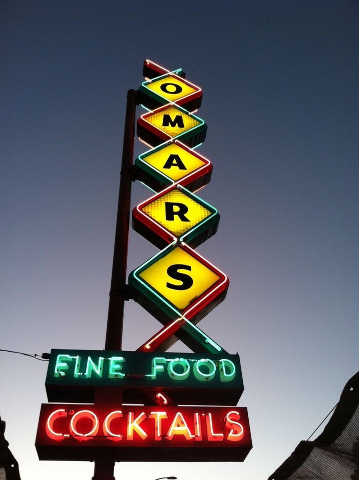 the old lit up Omar's restaurant sign