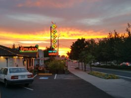 the outside of Omar's restaurant at sunset
