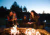 A family enjoying a fire in the fire pit at Salishan Lodge