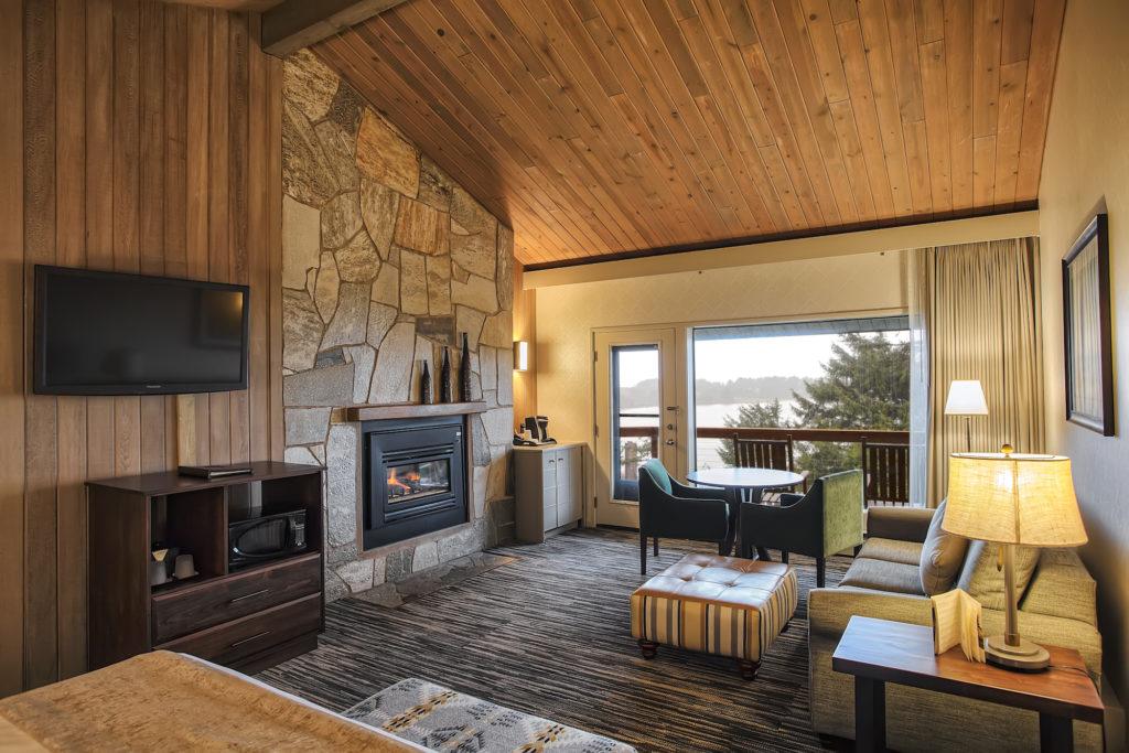 A luxurious room with a fireplace at Salishan Coastal Lodge