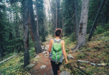 A woman hiking in the woods