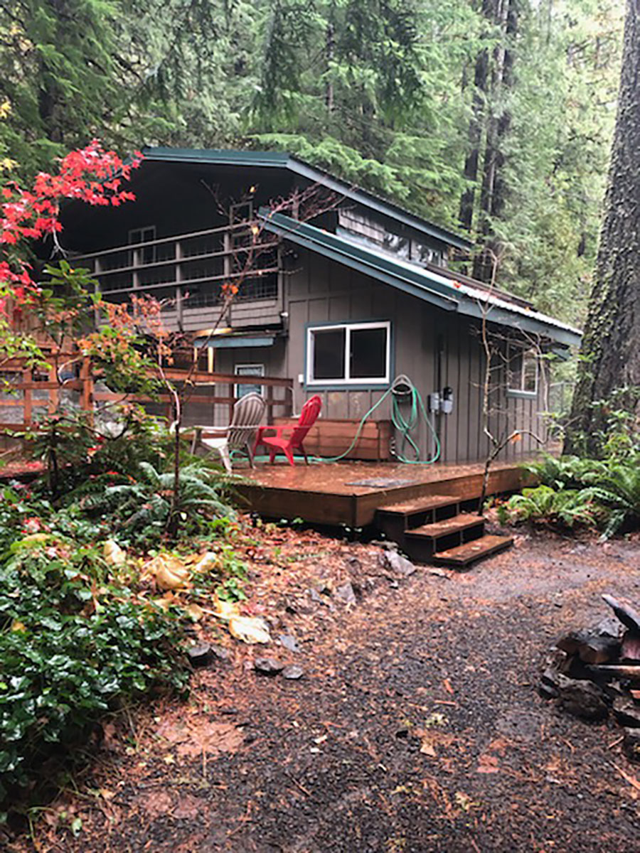 A cabin rental at Belknap Hot Springs in the forest