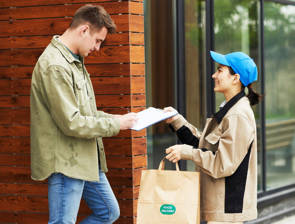 A man receiving a food delivery