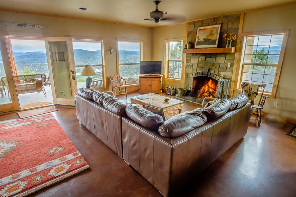 The living room with a couch and fireplace
