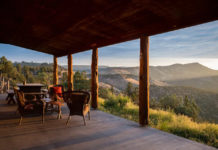 The covered front porch of the cabin looking out over the desert