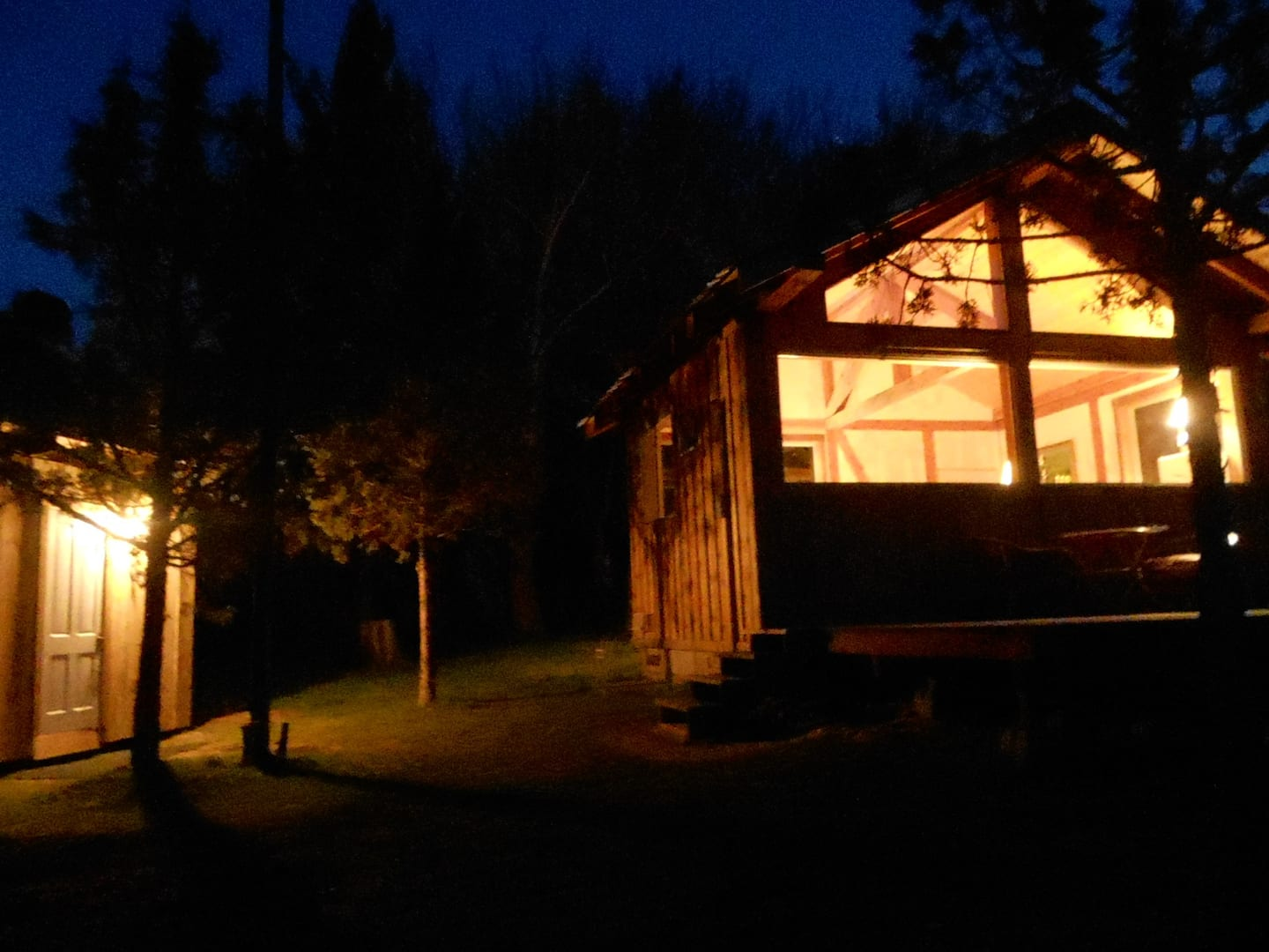 Cabin at night with lights on inside
