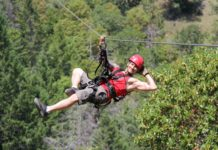 A person on a zipline at Rogue Valley Zipline Tour