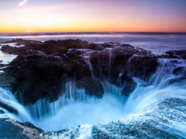 Thor's Well at sunset near Yachats Oregon.