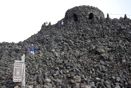 A circular castle like observatory made of stone in the Oregon Cascade Mountains.