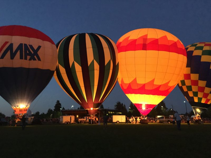 Hot air balloons lit up at night in Redmond Oregon