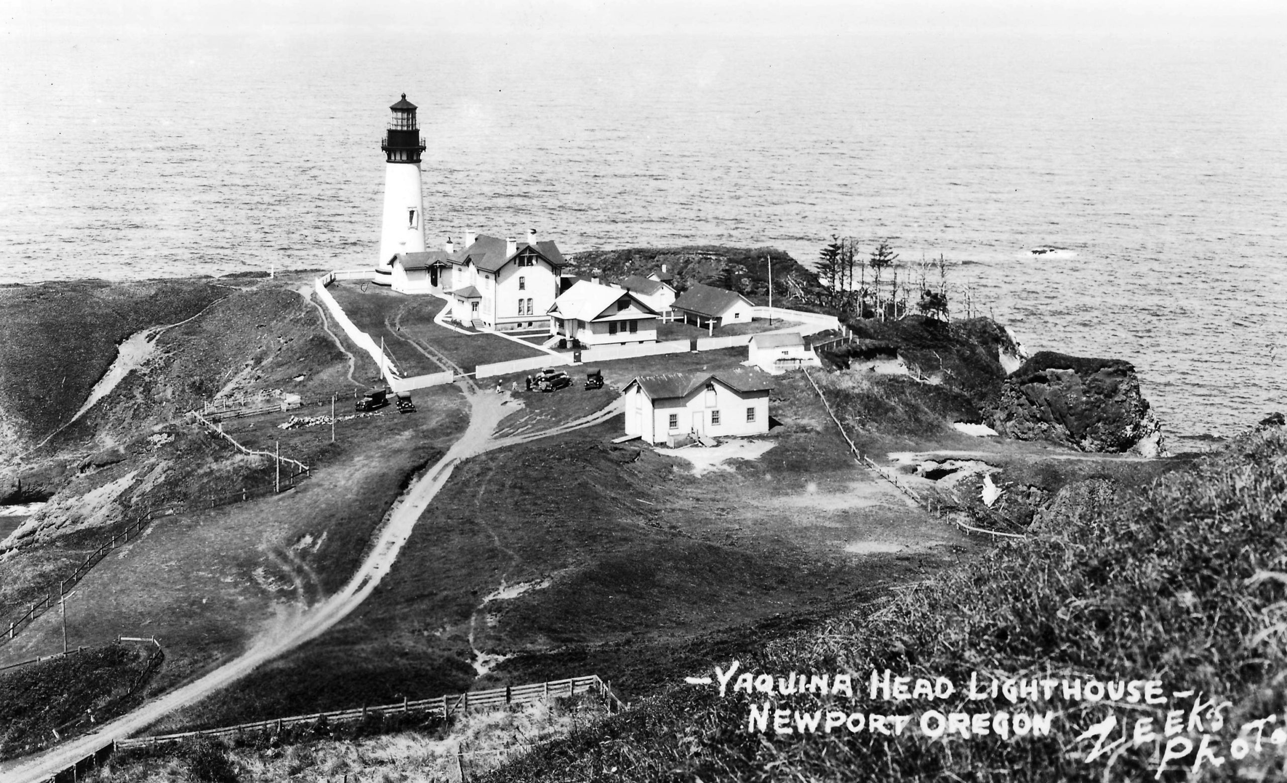 A black and white photo of Yaquina Head Lighthouse.