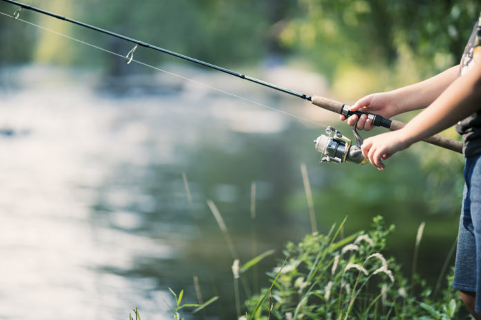 A person fishes in a river.