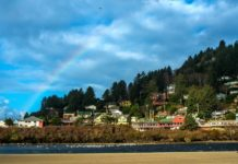 yachats oregon with a rainbow in the sky
