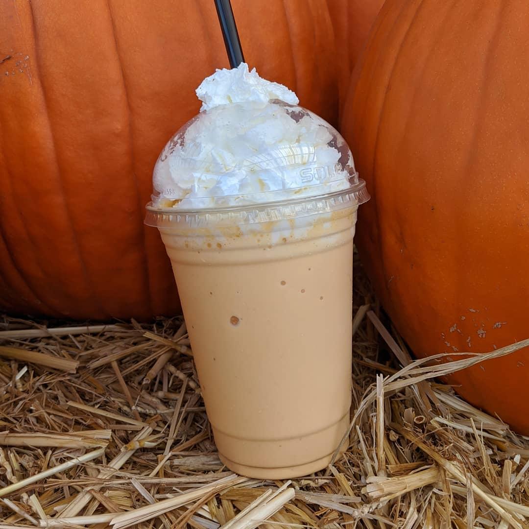 Pumpkin Milkshake in front of pumpkins