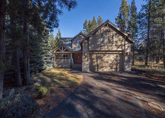 A gorgeous cabin in Sunriver Oregon surrounded by trees.