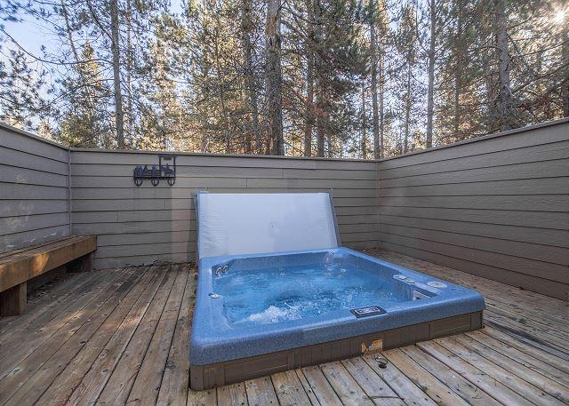 A private hot tub on a deck at a cabin in Sunriver Oregon near Bend.