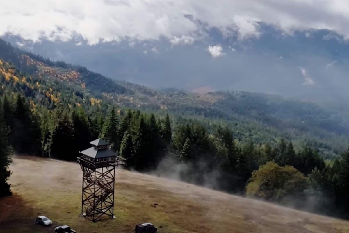 An aerial view of the mountains and lookout tower airbnb in Oregon