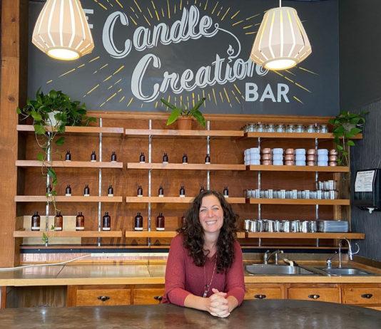 A woman at the candle creation bar at Yo Soy
