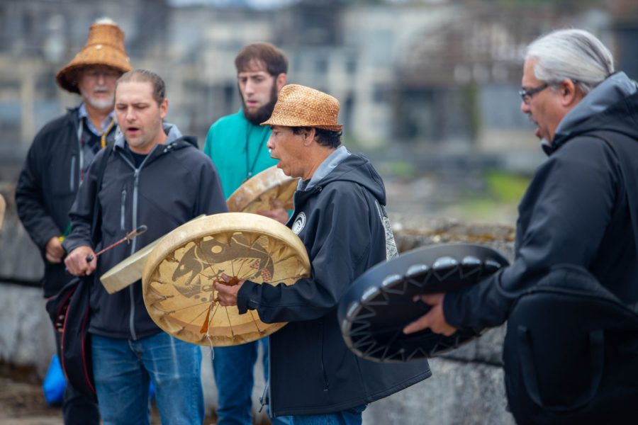member of the grande ronde tribe play ceremonial drums at willamette falls oregon