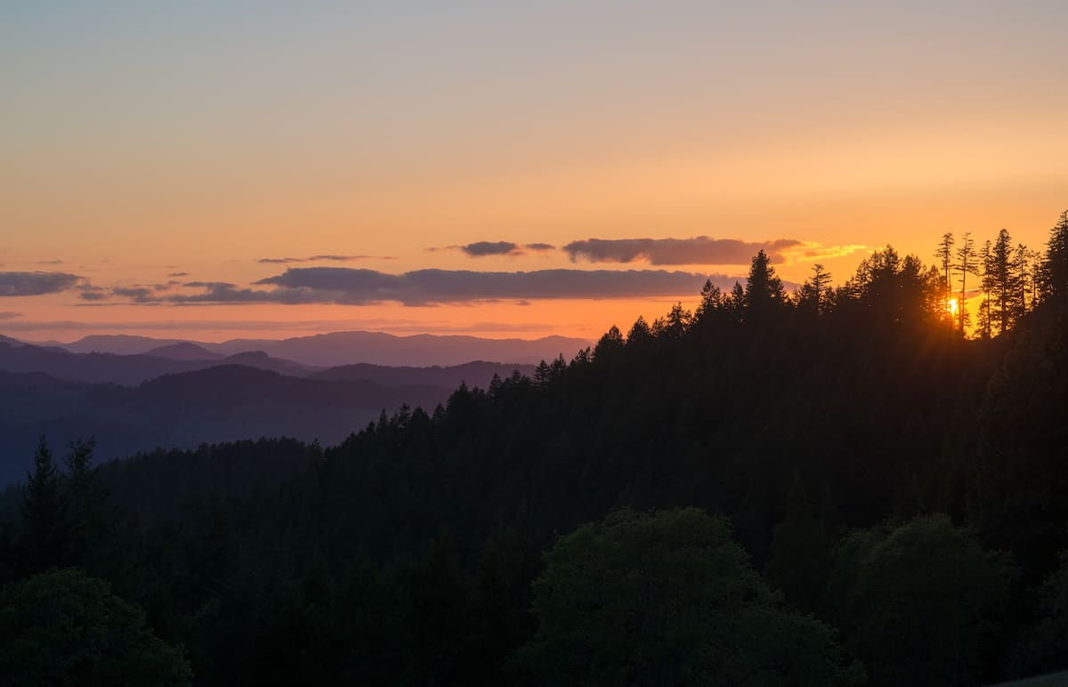 A great sunset view from the lookout tower over the silhouette of mountains and forests