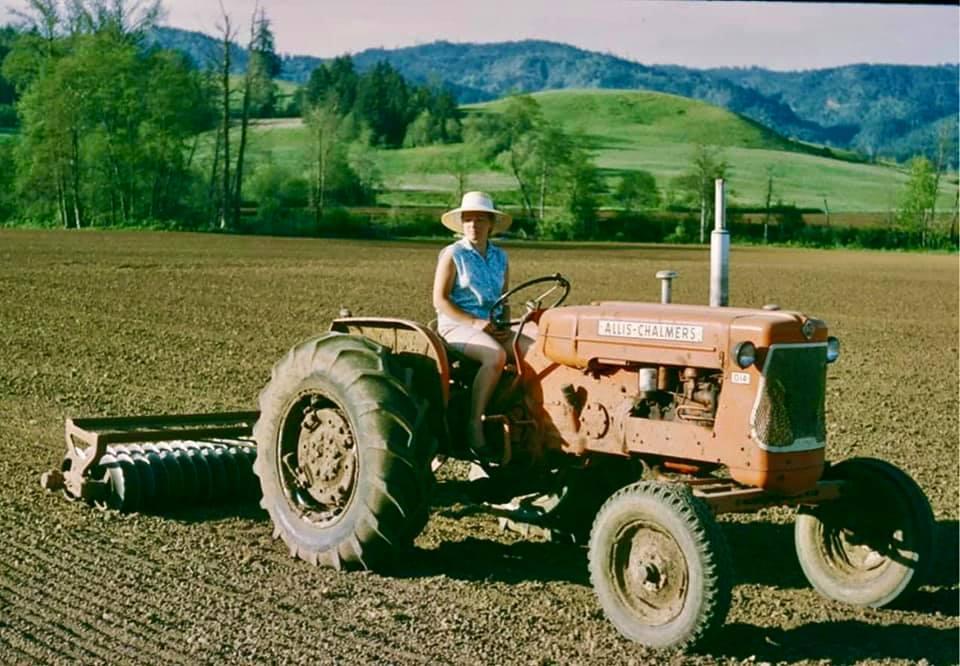 nancy scott on a tractor in scoggins valley oregon