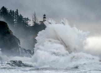 A massive wave crashing on coastal cliffs in Oregon.