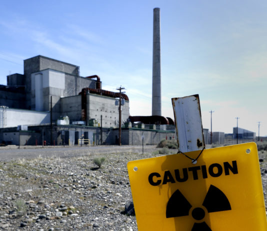 hanford washngton reactor with yellow radiation sign